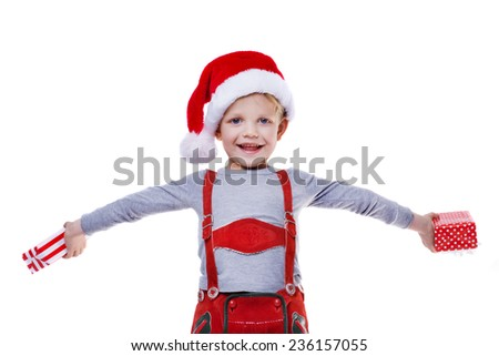 Beautiful little boy holding presents from Santa Claus. Christmas. Studio portrait isolated over white background   - stock photo