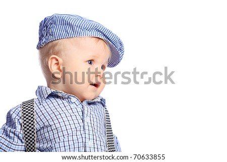 Beautiful little boy. Shot in a studio. Isolated over white background. - stock photo
