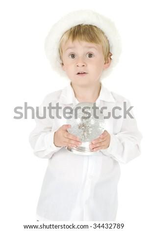 beautiful Little boy wearing santa hat holds Christmas large snowflake globe. very angelic - stock photo