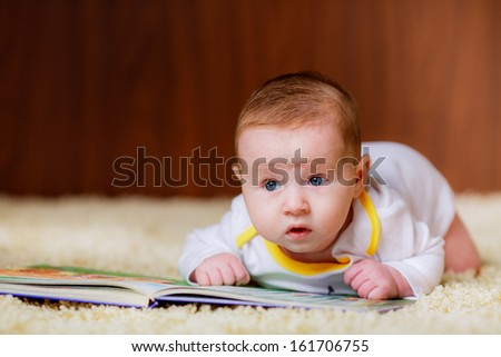 beautiful little boy with a book