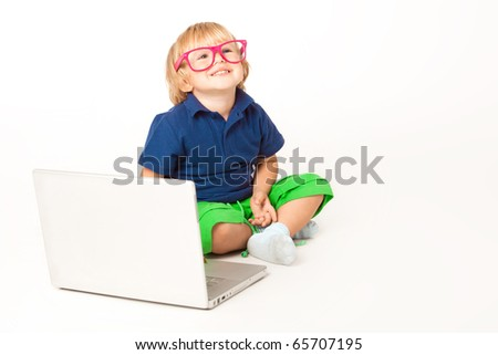 Beautiful little boy with his laptop - stock photo