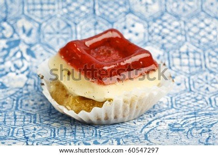Beautiful little cake on colorful wallpaper background