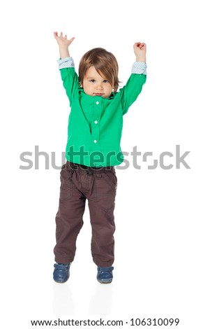 Beautiful little child, 2 years old boy, with hands up in the air, wearing shirt and jeans. High resolution image isolated on white background with copy space. Studio shot.