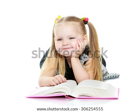 Beautiful little chubby girl long blonde braids on his head reading a book. The girl lies on the floor and dreams - stock photo