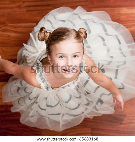 Beautiful little dancer. Ballerina in  princess dress - stock photo