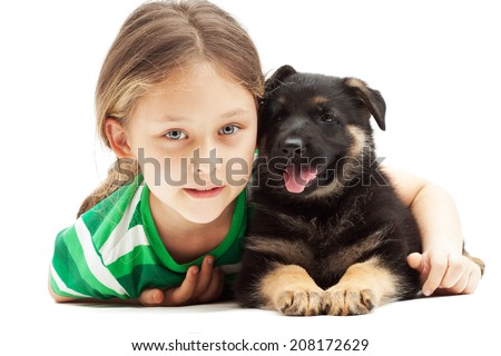 beautiful little girl and a German Shepherd puppy on white background