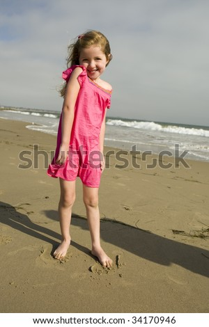 Beautiful little girl at the beach