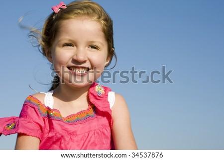 Beautiful little girl at the beach - stock photo