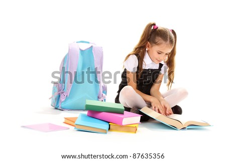 beautiful little girl, books and a backpack isolated on white - stock photo