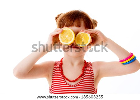 beautiful little girl citrus isolated on white background. happiness. emotions - stock photo