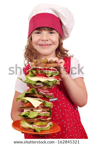 beautiful little girl cook with tall sandwich