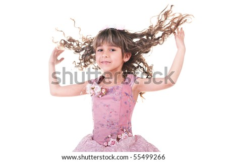 Beautiful little girl dancing and hands up - stock photo