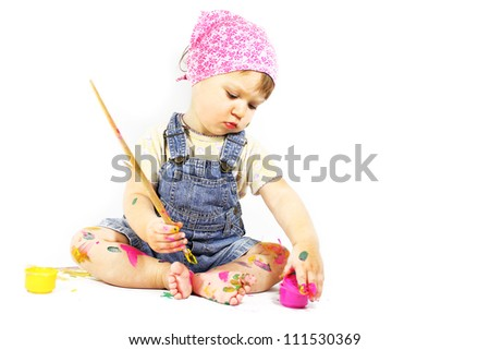 beautiful little girl draws paints