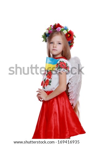 Beautiful little girl dressed in traditional Ukrainian costume over white background/Ukrainian angel on Christmas time