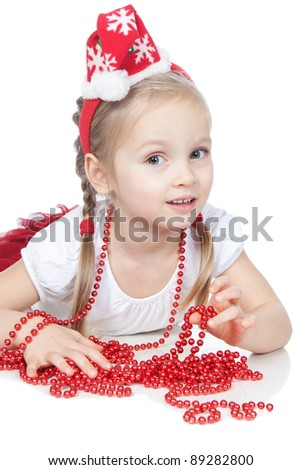 Beautiful little girl dressing in Santa's Helper hat with christmas' beads over white - stock photo