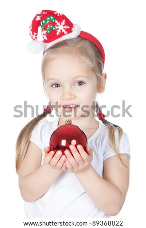 Beautiful little girl dressing in Santa's Helper hat with Christmas decorations over white - stock photo