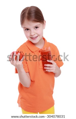 beautiful little girl drink tasty red tomato juice isolated over white background - stock photo