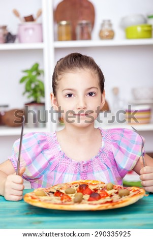 Beautiful Little girl eating pizza  - stock photo