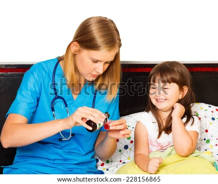 Beautiful little girl gladly taking her syrup for her cough. - stock photo
