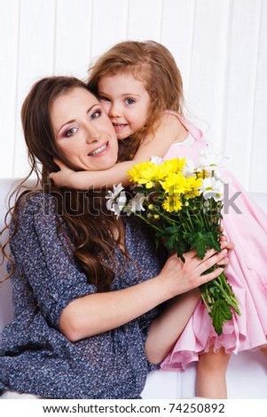 Beautiful little girl greeting her mother - stock photo