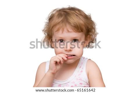 Beautiful little girl holding a shaped lollipop - stock photo