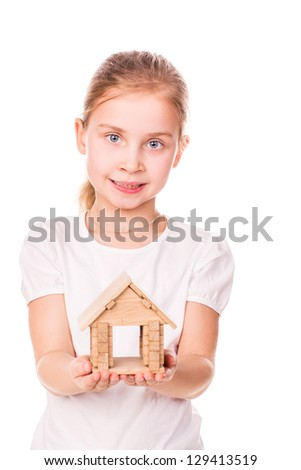 Beautiful little girl holding a toy model house isolated on white.  Buying a house concept. - stock photo