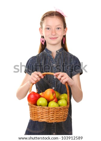 beautiful little girl holding basket of apples isolated on white