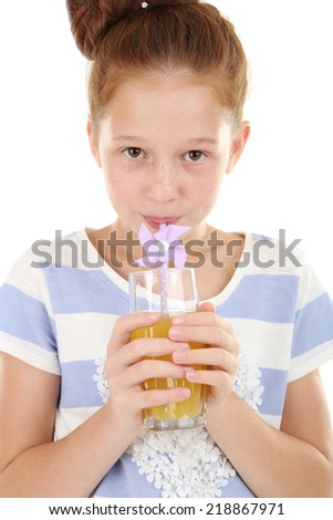 Beautiful little girl holding glass of juice close up