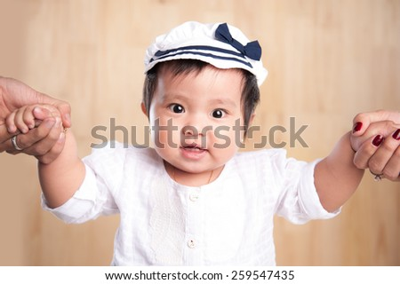 beautiful little girl holding the hand of my father and mother - stock photo
