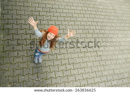 Beautiful little girl holds up hands. - stock photo