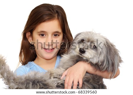 Beautiful little girl hugging her dog isolated on a white background - stock photo
