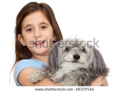 Beautiful little girl hugging her dog isolated on a white background