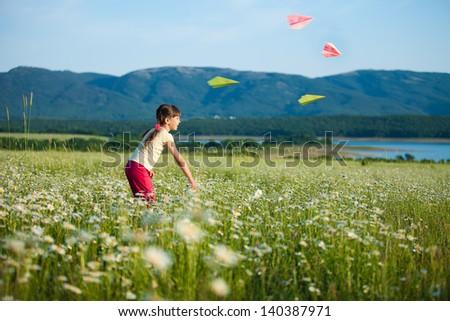beautiful little girl in a meadow - stock photo