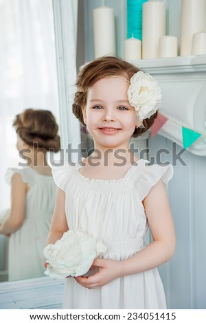 Beautiful little girl in a white dress - stock photo