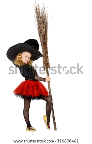 Beautiful little girl in a witch costume posing with a broom. Halloween. Isolated over white. - stock photo