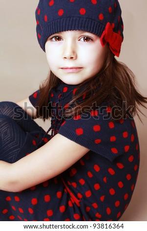 Beautiful little girl in beret. Studio shot - stock photo