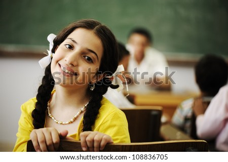 Beautiful little girl in classroom - stock photo