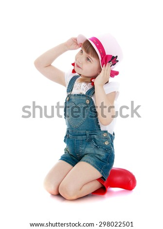 Beautiful little girl in denim shorts , red boots and hats sitting on your lap-Isolated on white background