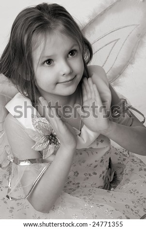 beautiful little girl in fairy dress with butterfly wings