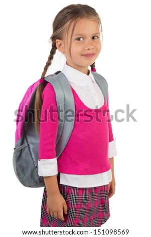 Beautiful little girl in pink school uniform and a backpack, isolated - stock photo