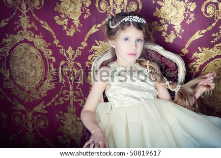 beautiful little girl in princess dress with long hair, studio set - stock photo