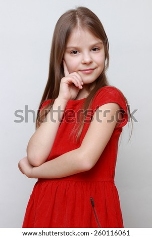 Beautiful little girl in red dress - stock photo