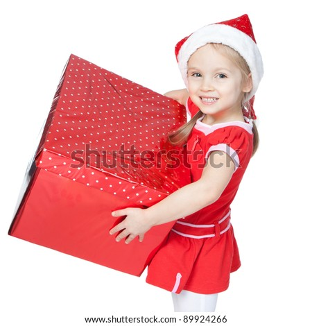 Beautiful little girl in Santa's Helper hat holding big red gift over white - stock photo