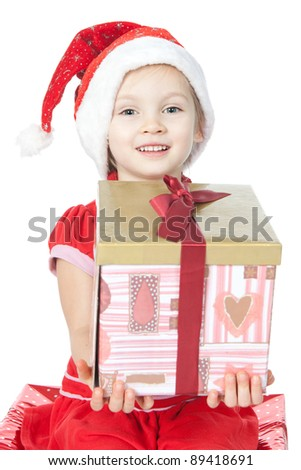 Beautiful little girl in Santa's Helper hat holding gift over white - stock photo