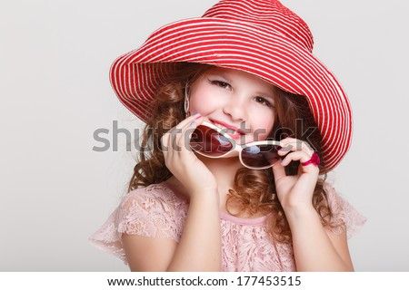 Beautiful little girl in summer hat and sunglasses on white background, portrait of cute happy child baby girl in lace princess dress in studio. kid summer fashion. isolated. - stock photo