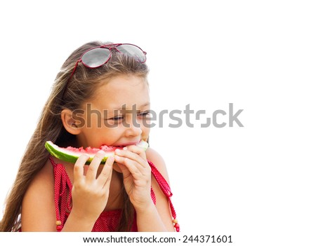 beautiful little girl in sunglasses eating juicy watermelon on a white background isolated
