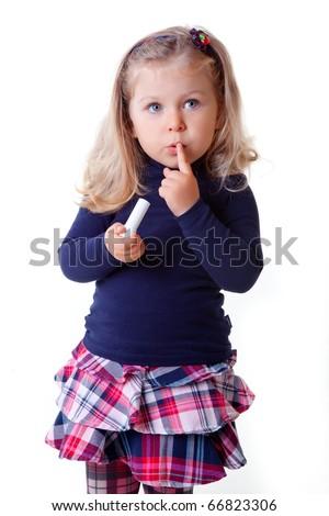 beautiful little girl in the Scottish skirt - stock photo
