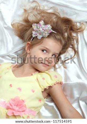 beautiful little girl in the studio shooting - stock photo