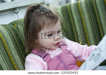 Beautiful little girl laughing in a restaurant