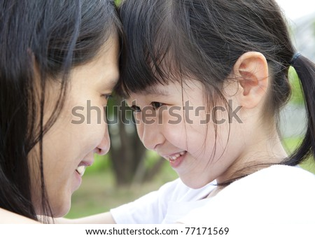 Beautiful little girl looking her mother - stock photo